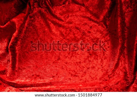 Luxurious Red Velvet Background for Christmas, Valentines, and other themes themes. Fabric has soft folds and ripples with shaded and lighter areas for copy space and dramatic effect.