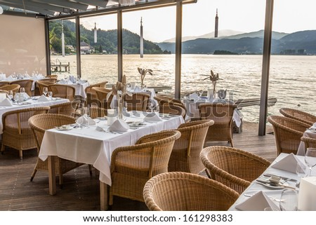 Luxurious restaurant with tables on pier at a Lake in Austria #161298383
