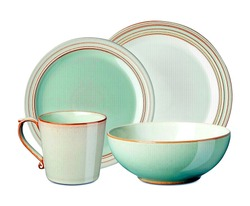 Luxurious set of dinnerware on white background.   Interior element. aqua colored dinnerware set