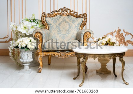 Luxurious vintage interior in the aristocratic style with elegant armchair and flowers. Retro, classics. #781683268