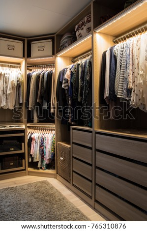 Luxurious walk in closet with lighting and jewelry display. #765310876