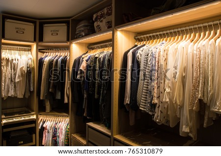 Luxurious walk in closet with lighting and jewelry display. #765310879