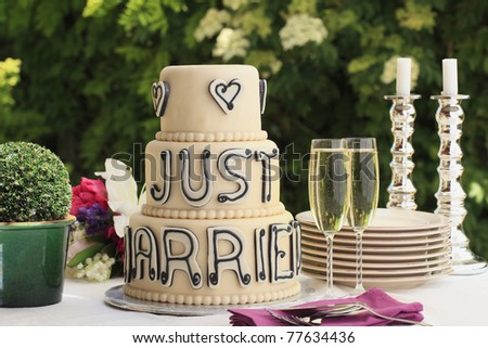 stock photo Luxurious wedding cake and two champagne flute glasses on the