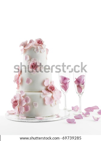 stock photo Luxurious wedding cake with flowers and two champagne flute
