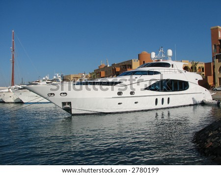 luxurious yacht moored at sunny bay