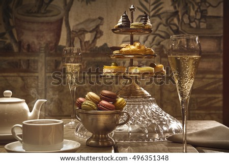 luxury afternoon hot tea with champagne and macaroons #496351348