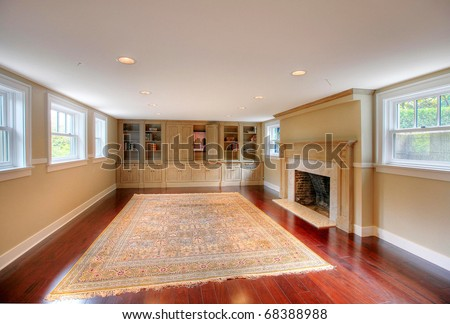 luxury basement with upper windows large old fire place and build ins