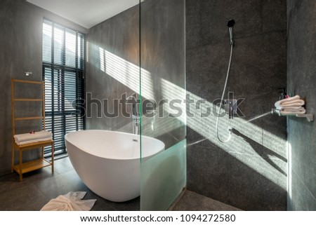 Luxury bathroom features basin, toilet bowl and bathtub home, house , building , hotel , resort