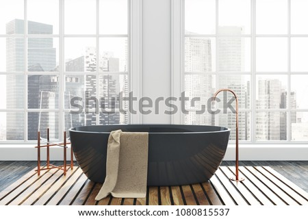 Luxury bathroom interior with a dark wooden floor, white walls, and a black bathtub. A beautiful cityscape seen through the windows. 3d rendering Foto d'archivio ©