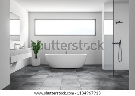 Luxury bathroom interior with white walls, a tiled black floor, a white bathtub, a shower and a double sink. A narrow horizontal window. Scandinavian style. 3d rendering