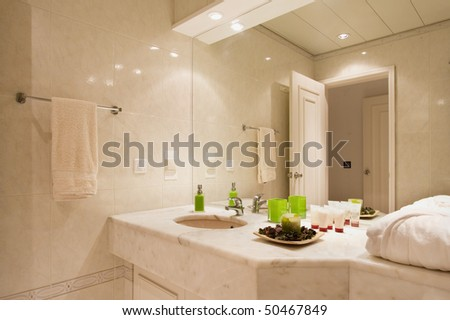 Luxury bathroom with brown tiles
