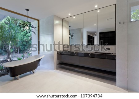 Luxury bathroom with mirror, sink and classic bathtub