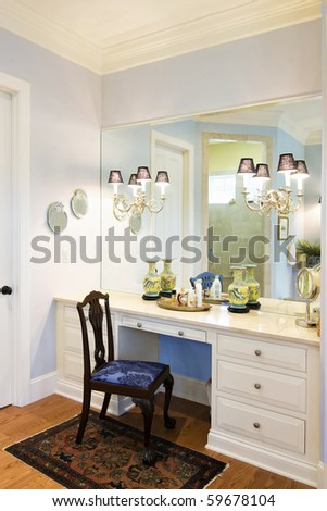 luxury bathroom with vanity and mirror