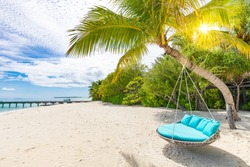 Luxury beach background as summer landscape with beach swing or hammock and white sand and calm sea for beach banner. Perfect beach scene vacation and summer holiday concept. Boost up color process