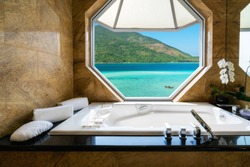 Luxury beautiful interior design on beach resort, window view from bathroom on clear blue sea, summer vacation in Phuket, Thailand. Summer, Travel, Vacation and holiday concept.
