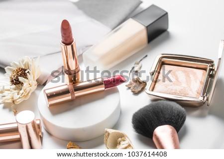 luxury beautiful light  design cosmetic makeup brand brand gold nude orange pink lipstick foundation blusher bronzer brush flower accessories white background