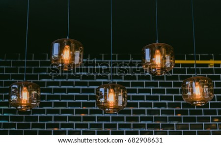 Luxury beautiful retro edison light lamp decor.Incandescent lamps in a modern cafe. Edison lamp.