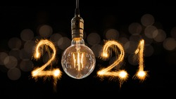 Luxury beautiful retro or vintage dirty light bulb decor hanging with 2021 Happy new year concept written number by sparkle firework