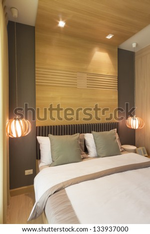 Luxury Bedroom Decorated With Wood From Headboard To Ceiling.