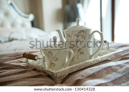 luxury bedroom interior with beverage on bed
