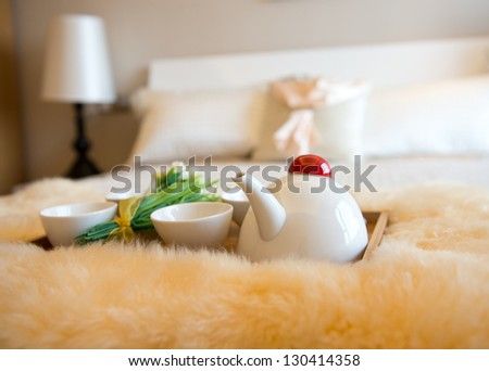 luxury bedroom interior with beverage on bed.