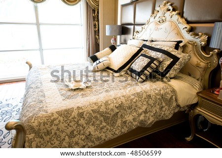 luxury bedroom interior with breakfast on bed.