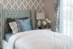 luxury bedroom with classic single bed and set of pillows, interior design