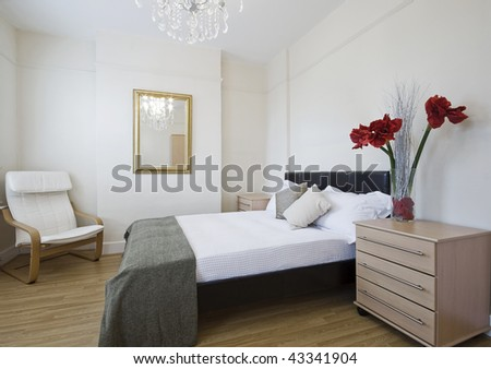 luxury bedroom with modern furniture and flowers