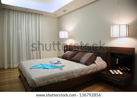 luxury bedroom with modern wooden furniture