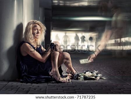 luxury beggar girl is sitting on the floor in subway