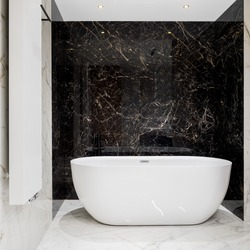 Luxury big oval bathtub in bathroom with black and white marble tiles on walls and floor