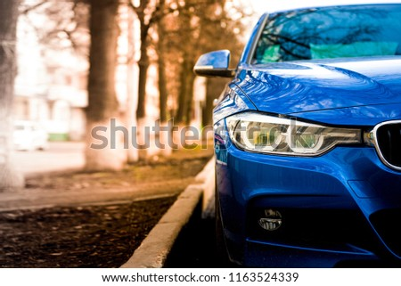 luxury blue car front view. sunlight