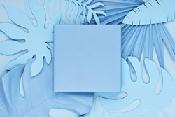 Luxury blue square podium, and palm leaves in pastel background. Concept scene stage showcase, for product, promotion, sale, banner, presentation, cosmetic. Minimal showcase mock up concept.