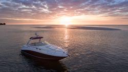 Luxury Boat  Anchored by Sandbar in Sarasota Florida during sunset