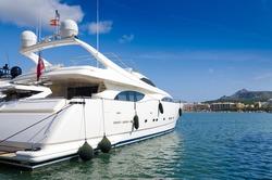 Luxury boat in tropical marina