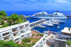 Luxury boats and large cruise ship inside the main harbor of Monaco