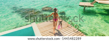 Luxury Bora Bora resort woman going snorkeling from overwater bungalow panoramic. Tahiti paradise destination vacation. #1445482289