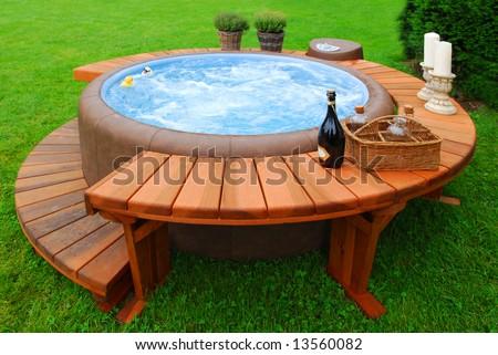 Luxury bubble bath in a green garden