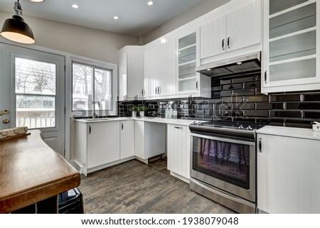 Luxury Canadian House Completely Renovated, Furnished and Staged with Basement, Deck, Backyard and Garage for Sale Сток-фото ©
