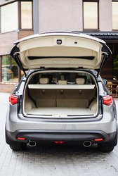 Luxury car boot with folded seats. Opened empty car trunk. Clean trunk of the SUV.