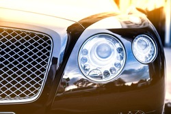 luxury car head lamp on blurred background