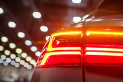 Luxury car headlight close-up. Concept of expensive, sports auto.  The concept of tuning. Headlight of  modern prestigious car.