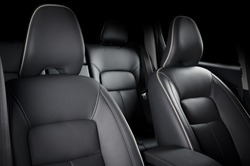 Luxury car inside. Interior of prestige modern car. Comfortable leather seats. Black perforarated leather cockpit.