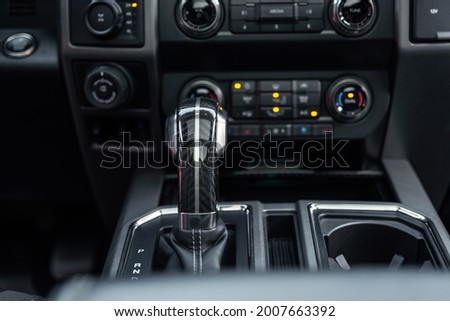 Luxury car interior. Control panel, radio system, shift lever. Automatic transmission gearshift stick. Selective focus. Stock photo ©