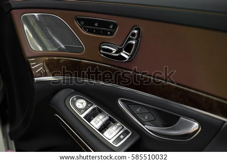 Luxury Car Interior Details Of Door Handle With Windows Controls And