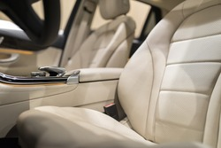 Luxury car interior with close-up on leather seats