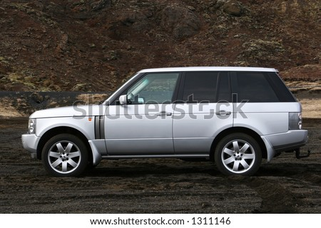 Luxury car, shot from the side on a desolate beach