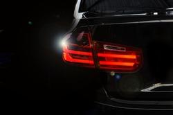 Luxury car tail light on a black background.Copy space car black