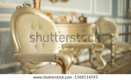 Luxury chair in a luxurious blurred room