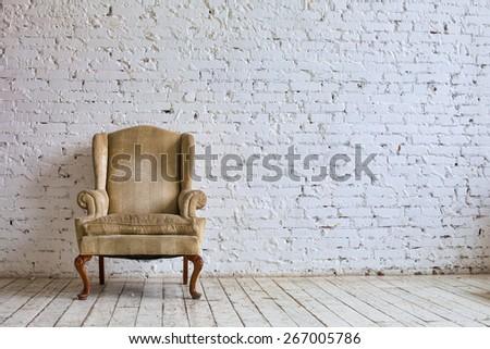 Luxury chair near white brick wall #267005786